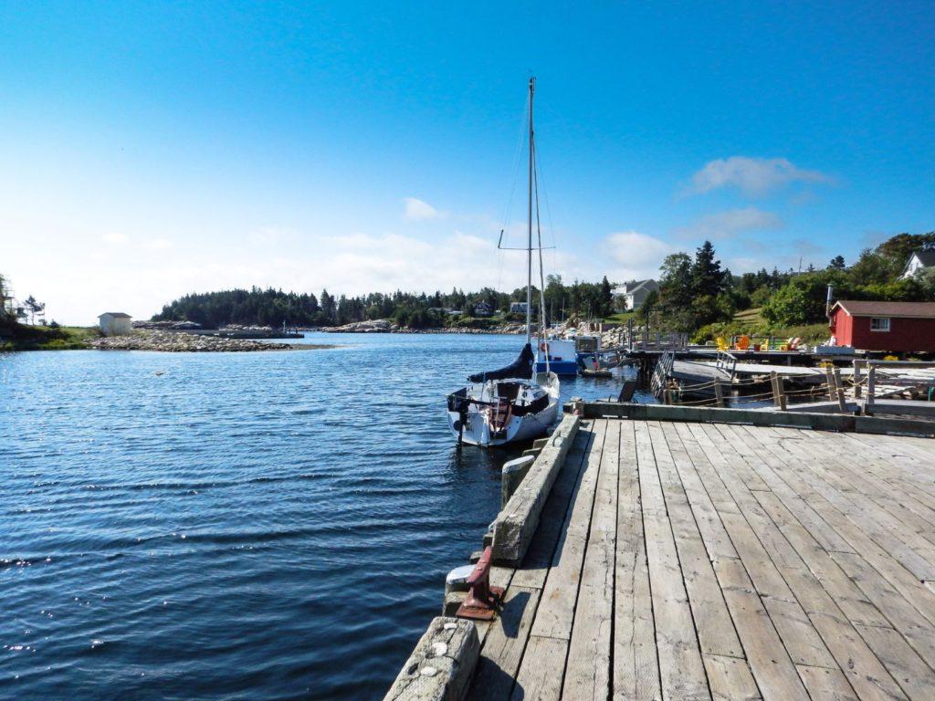 Fishing boat at a wooden dock. Blue Sky, blue ocean. Saint John Rehab, Saint John Drug and Alcohol Rehab, New Brunswick Rehab.